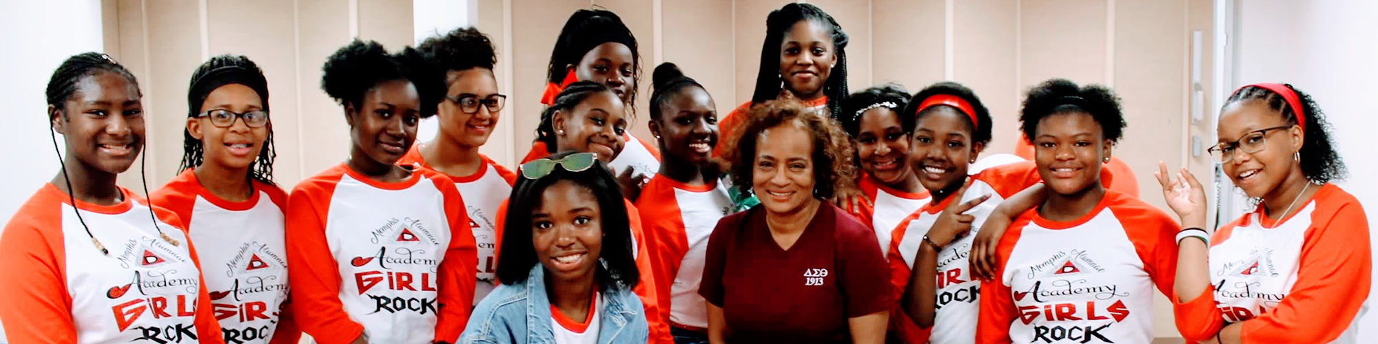 Image of Vera Hawkins with 13 young ladies wearing Memphis Alumnae Academy Girls Rock t-shirts.
